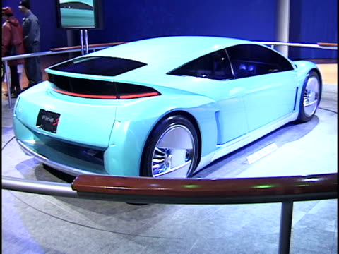 rear end of toyota fine-s fuel cell concept car revolving on turntable / front end of car revolving on turntable 2003 toyota fine-s concept car... - audio hardware stock videos & royalty-free footage