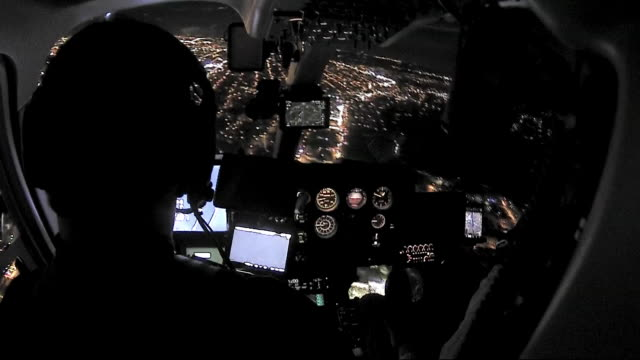 rear helicopter pilot flying toward newark airport in newark, new jesey at night. - control stock videos & royalty-free footage