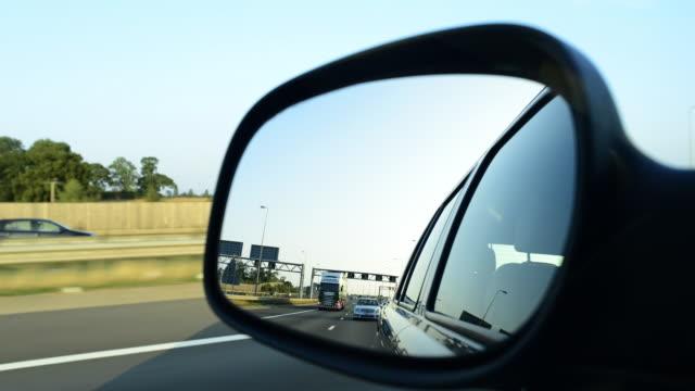 rear mirror pov - major road stock videos & royalty-free footage