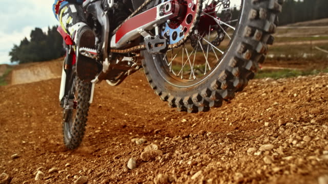 slo mo rear motocross bike tire blasting gravel around - competition stock videos & royalty-free footage