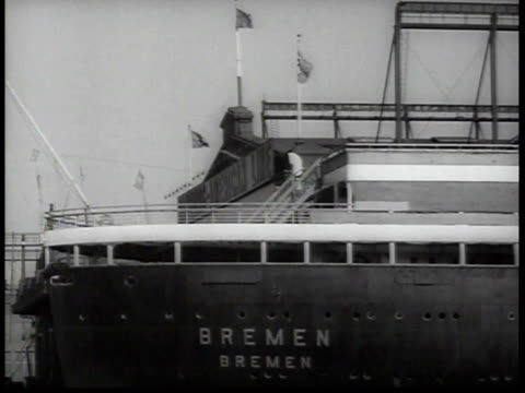 ms rear of ss bremen with name visible at new york city dock with nazi flags waving / new york usa - hakenkreuzfahne stock-videos und b-roll-filmmaterial