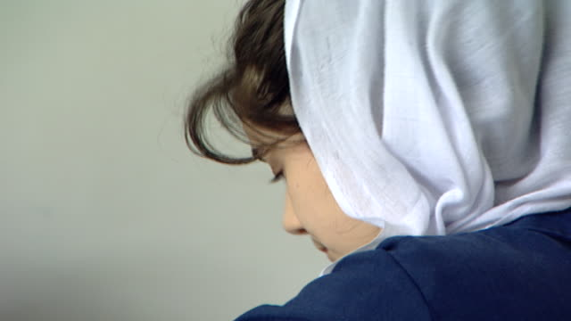 rear on the profile of a schoolgirl wearing a white veil known as a mandil, traditional druze attire, at irfan, a druze religious school in the chouf... - profile produced segment stock videos & royalty-free footage