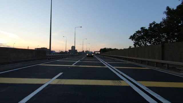 rear point of view driving on motorway.real time. dusk. - road marking stock videos & royalty-free footage
