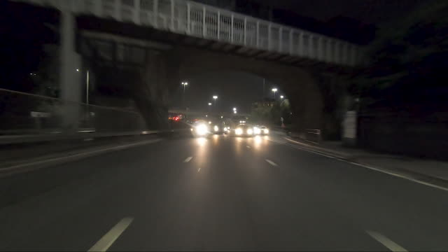 rear point of view driving on motorway.real time. night. - rear view stock videos & royalty-free footage