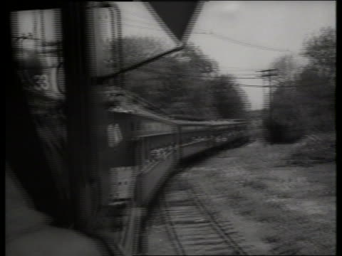 vídeos y material grabado en eventos de stock de b/w rear point of view of train driving on tracks in countryside / new jersey / sound - locomotora