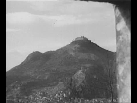 rear shot allied officer looks through binoculars at monte cassino in the background during world war ii campaign / through window opening of abbey... - us military stock videos & royalty-free footage