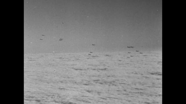 rear shot and ws bombers in flight in formation with some exuding contrails / pov from camera plane as bombers fly over bank of clouds / flying... - allied forces stock videos & royalty-free footage