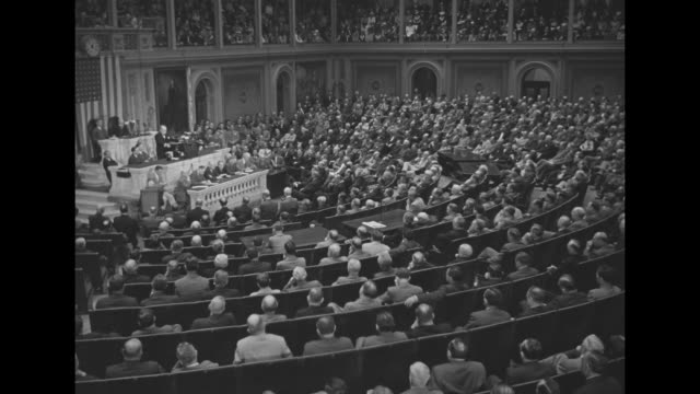 vídeos y material grabado en eventos de stock de ws rear shot audience in house of representatives chamber at us capitol listens as british pm winston churchill delivers speech to joint session... - united states congress