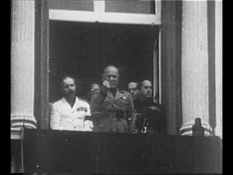 rear shot benito mussolini waves from balcony crowd stands below / pan crowd in piazza venezia / mussolini clenches his fist speaks emphatically from... - piazza venezia stock videos and b-roll footage