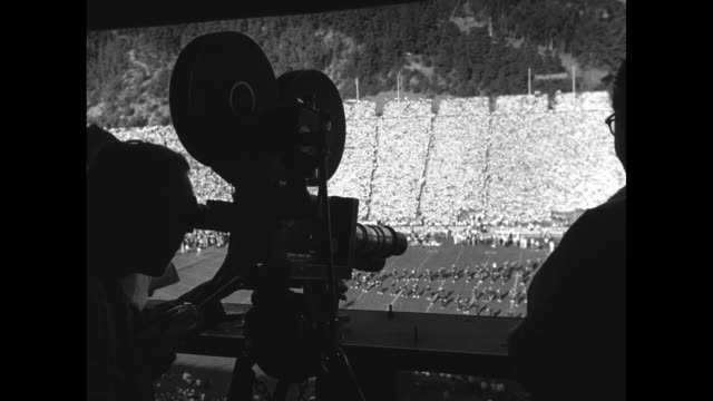 rear shot cameraman shoots film from stadium's upper deck of pregame proceedings prior to football game between the university of california berkeley... - university of california stock videos & royalty-free footage
