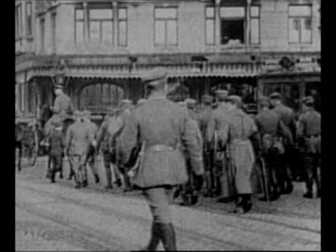 rear shot german army marches out of brussels during world war i retreat / king albert and queen elizabeth of belgium / crowds in streets welcome... - german military stock videos & royalty-free footage