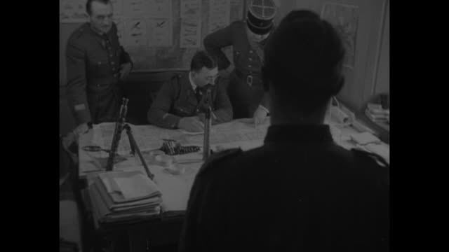 rear shot german pow and french guard face french deuxieme bureau officer at desk / the officer and another look at map on desk / rear shot pow and... - bajonett stock-videos und b-roll-filmmaterial