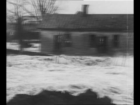 rear shot men watch as levee on the missouri side is blasted near cairo, illinois / montage water from ohio river let into the mississippi river via... - ta ner bildbanksvideor och videomaterial från bakom kulisserna