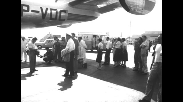 rear shot people board varig airlines flight / ext idlewild airport pan across bottom of plane fuselage to maintenance crew underneath wing / ws crew... - anne francis stock videos and b-roll footage