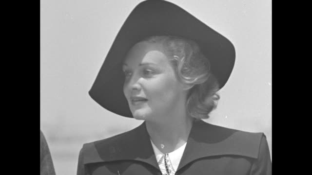 rear shot people watch american clipper plane at anchor / actress madeleine carroll deplanes greets people / cu carroll on airfield after visit to... - schauspielerin stock-videos und b-roll-filmmaterial