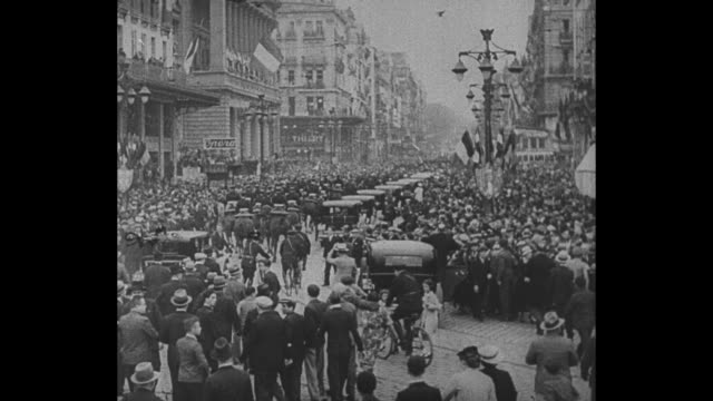 Rear shot procession of cavalry and automobile bearing King Alexander I of Yugoslavia and French foreign minister Louis Barthou moves in Marseilles...