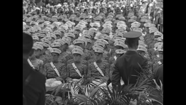 Rear shot spectators and cadets face stage at US Military Academy graduation ceremony at West Point NY / WS US President Franklin Roosevelt gives...