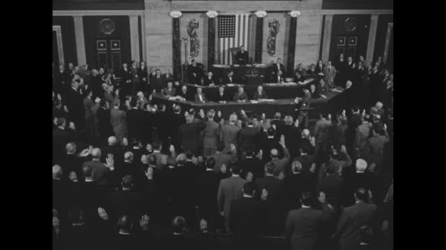 rear shot us house of representatives congressmen swear in for the beginning of the 83rd us congress / ws standing congressmen applaud / new speaker... - joseph w. martin jr stock videos & royalty-free footage