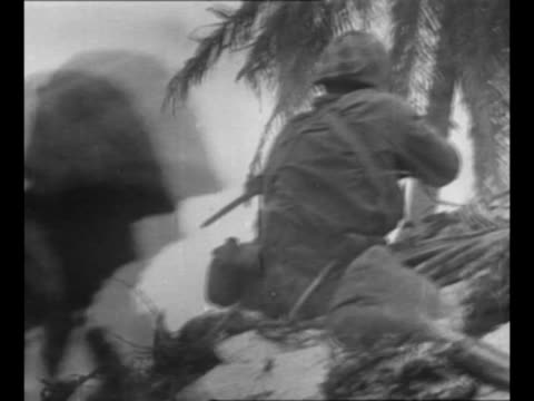 rear shot us marines pass camera as they run on beach, crouch / rear shot machine gun fires, with ammunition belt feeding into it / smoke in clearing... - other stock videos & royalty-free footage