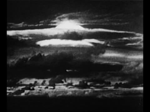 rear shot us sailors soldiers on ship shield their eyes from glare of detonation during first us test of hydrogen bomb / montage mushroom cloud from... - bikini atoll stock videos & royalty-free footage
