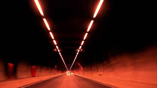 vídeos de stock, filmes e b-roll de rear time lapse car point of view through tunnel - imagem tonalizada