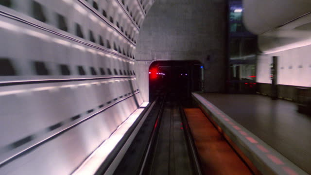 rear train point of view through stations and tunnels / washington, dc - underground train stock videos & royalty-free footage