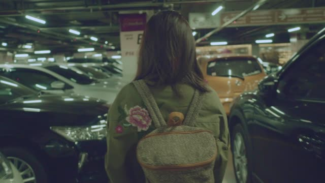 rear view : asian woman walking at the underground car park - car park stock videos & royalty-free footage