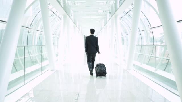 ws rear view businessman walking through tunnel - formal businesswear stock videos & royalty-free footage