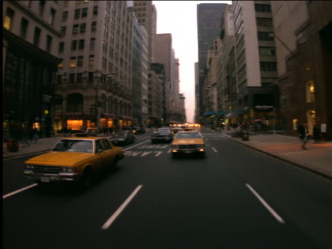 rear view car point of view on new york city street with traffic - yellow taxi stock-videos und b-roll-filmmaterial