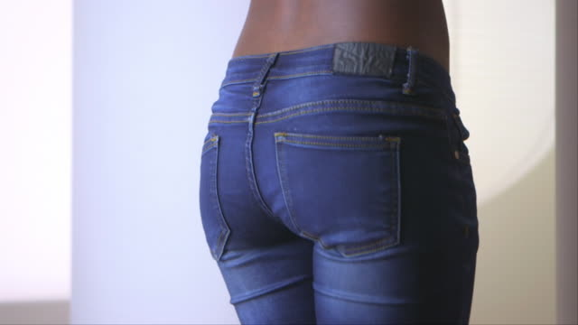 rear view close up of woman's jeans - pants stock videos and b-roll footage
