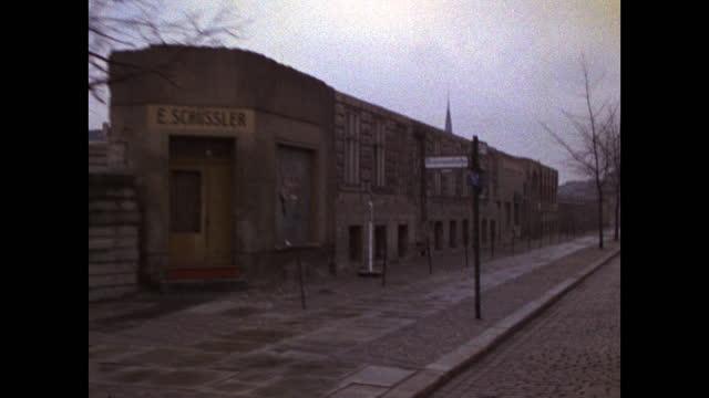 rear view driving along the berlin wall along an urban road in berlin; 1969. - national landmark stock videos & royalty-free footage