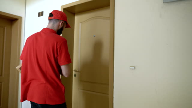 rear view footage of delivery boy ringing on the doorbell - man made object stock videos & royalty-free footage