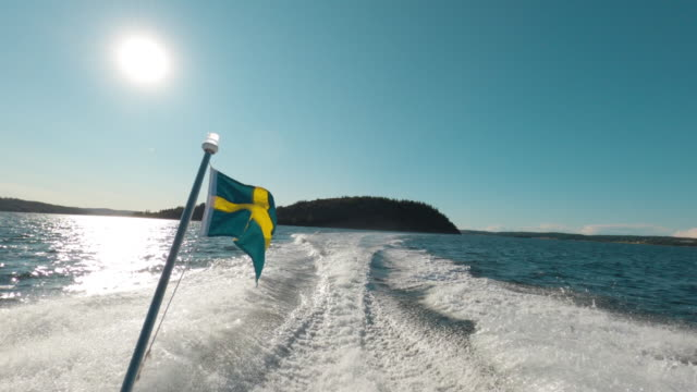 rear view from a motorboat with the swedish flag - viewpoint stock videos & royalty-free footage