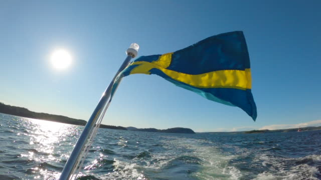 rear view from a motorboat with the swedish flag - motorboat stock videos & royalty-free footage