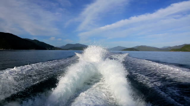 rear view from boat speeding on a lake - behind stock videos & royalty-free footage