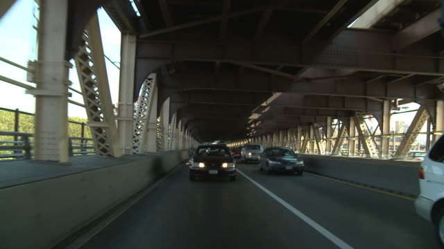 pov rear view from car driving on the 59th street bridge, westbound to queens from manhattan / new york city, new york, united states - girder stock videos & royalty-free footage