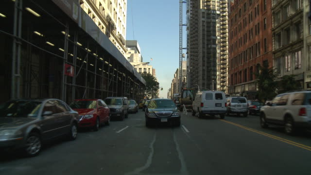 pov rear view from car driving on two way street with a lincoln town car / new york city, new york, united states - lincoln town car stock videos and b-roll footage