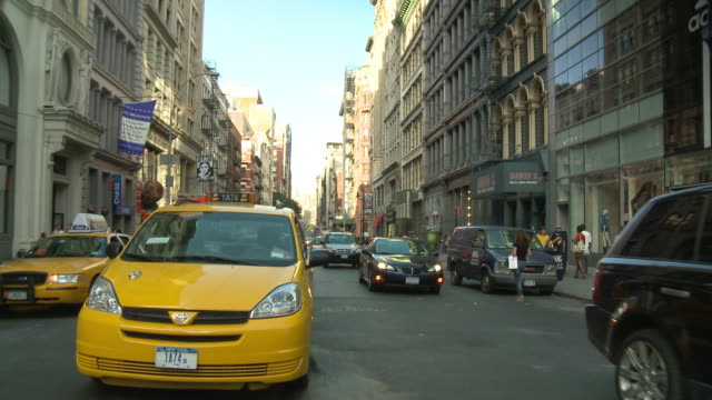 pov rear view from car turning a corner with taxis on bumpy street / new york city, new york, united states - lincoln town car stock videos and b-roll footage