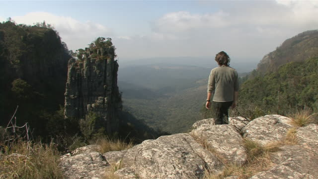 ws rear view if man looking at view from god's window in blyde river canyon / mpumalanga province, south africa - mpumalanga province stock videos and b-roll footage