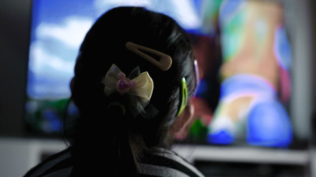 rear view : little girl watching television - television stock videos & royalty-free footage