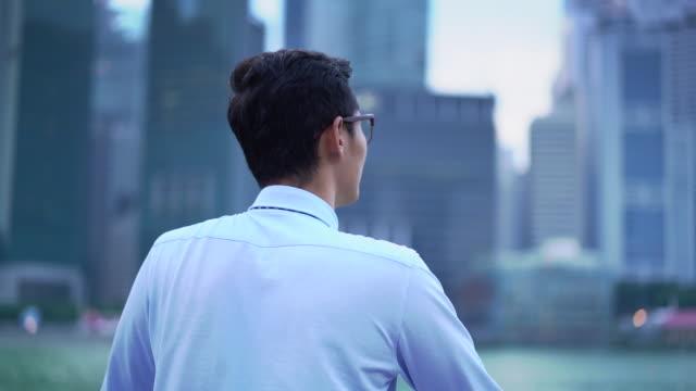 MS TS SM rear view Man looking at a city.