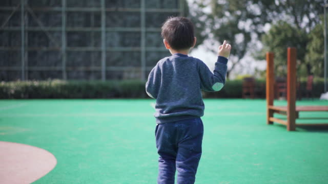 rear view of a boy running at playground - child care stock videos & royalty-free footage