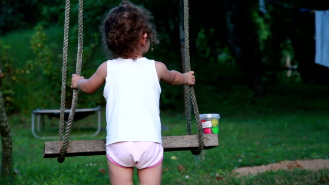 rear view of a child playing with a rope swing - underwear stock videos & royalty-free footage