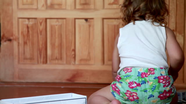 rear view of a little girl putting her toys in the box - tidy stock videos & royalty-free footage