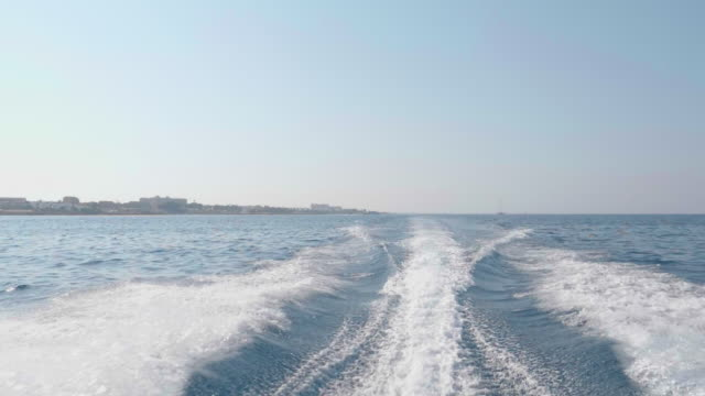 slo mo pan rear view of a speedboat wake - speed boat stock videos & royalty-free footage