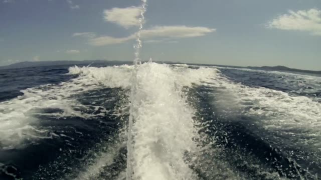 rear view of a water surface behind jet-ski - jet ski stock videos & royalty-free footage