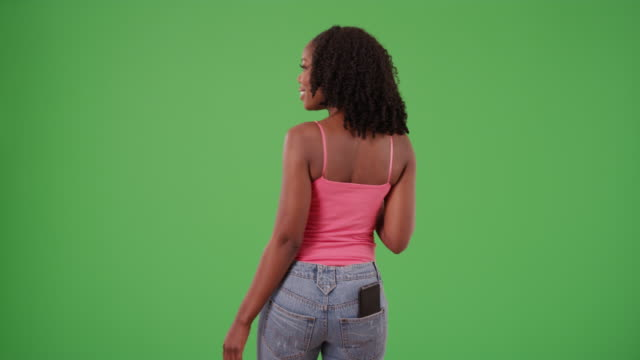 rear view of black female in tank top dancing, drinking water on greenscreen - dancing back to back stock videos & royalty-free footage
