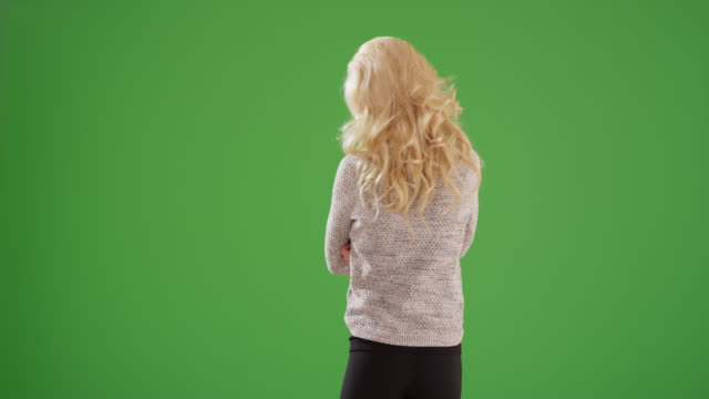 rear view of blonde caucasian woman on green screen - behind stock videos & royalty-free footage
