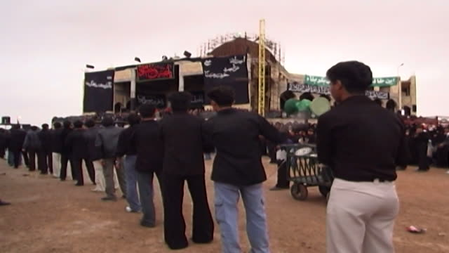 rear view of boys performing azadari rituals during ashura ashura the tenth day of the islamic month of muharram commemorates the death of hussain... - ashura muharram stock videos & royalty-free footage