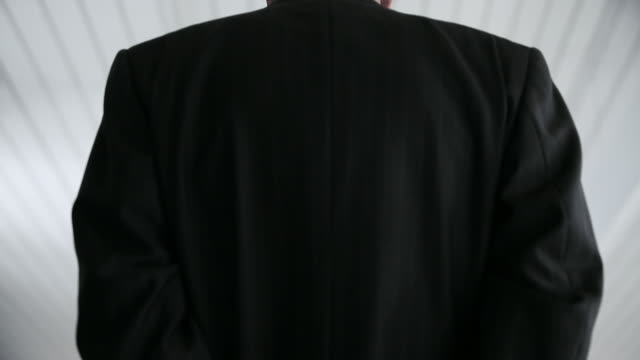 rear view of businessman in handcuffs - trapped stock videos & royalty-free footage